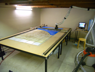 This is a very large-bed 75W CO2 laser cutter, custom made when I needed beam time for a large scale project that needed many hours of cutting.  Typical CO2 lasercutters are not this large (the bed on this cutter is 5' x 10') because of beam dispersion issues.  Higher-powered laser cutters are prohibitively costly when you're in service-bureau mode.